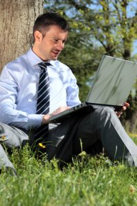 working with laptop in a park mobile ergonomics