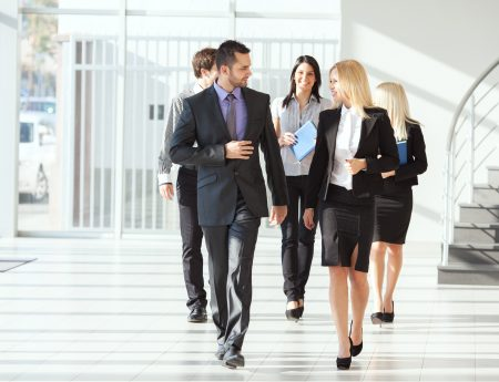 employees walking out of meeting together