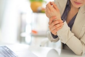 Closeup on business woman with wrist injury