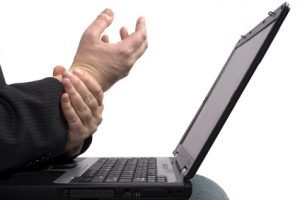Business man with RSI Carpal Tunnel Syndrome