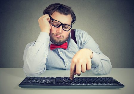 employee clumsily typing on keyboard