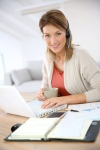 Businesswoman attending video conference working from home
