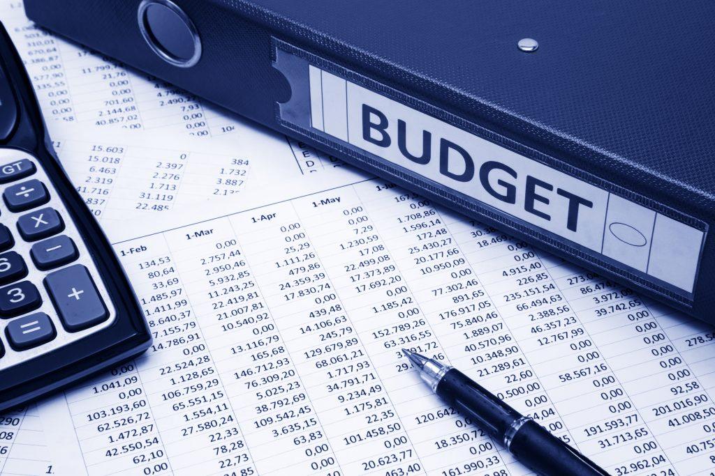 accounting sheets, binder and calculator