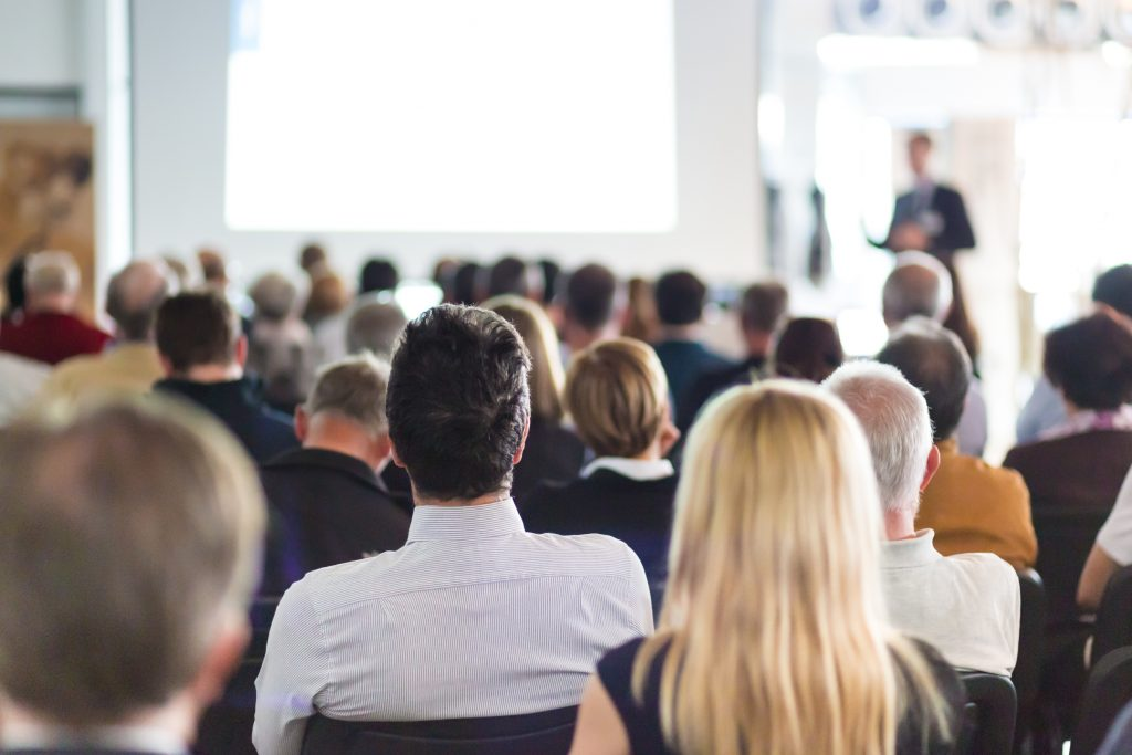group of people listening to presentation