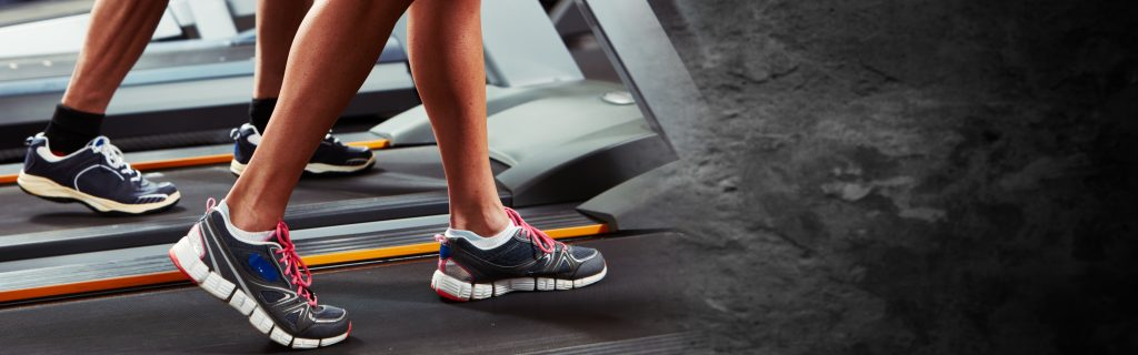feet of 2 people using treadmill