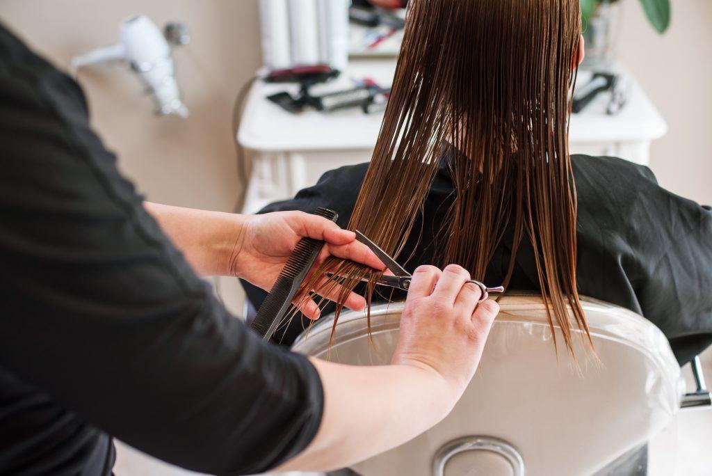barber cutting women's hair