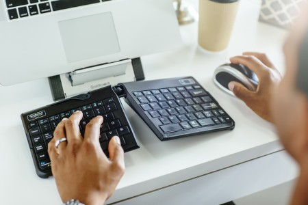 man at desk with keyboard and mouse