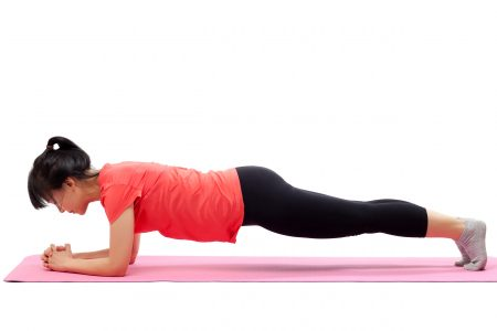 Woman doing plank exercise core strength
