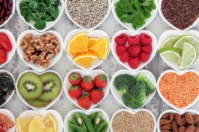 fruits, vegetables and grains in heart shaped containers