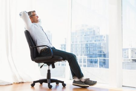 Man Making Office Chair More Comfortable