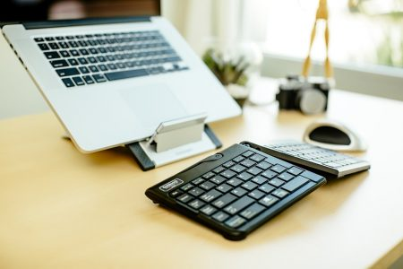ergonomic keyboard and laptop stand for proper typing