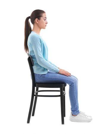 women sitting on chair