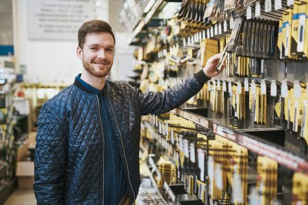 man in aisle at store