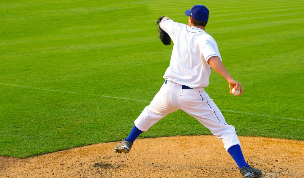Professional baseball pitcher throwing the ball